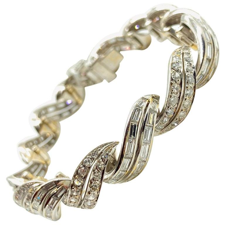 Art Deco 10 Carat Diamond White Gold Swirl Bracelet For Sale