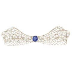 Art Deco 1.00 Carat Sapphire and Diamond Bow Brooch, circa 1920s