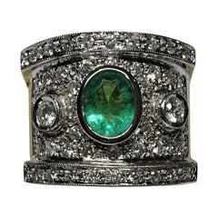 Art Deco 1.01 Carat Oval Emerald White Diamond 18 Karat Gold White Gold Ring