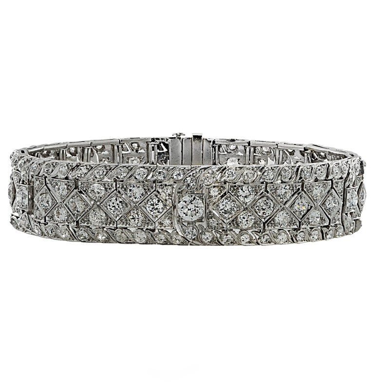 Spectacular Art Deco bracelet crafted in platinum showcasing 182 Old European cut diamonds weighing approximately 10.25 carats total, G-H color, VS-SI clarity. The diamond encrusted openwork plates showcase the diamonds in a magnificent design with
