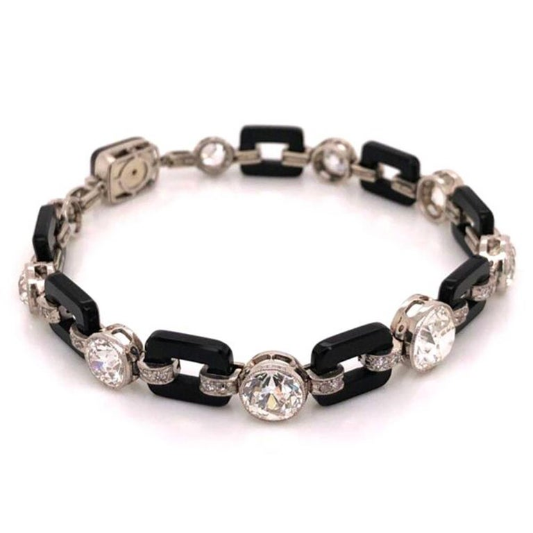Simply Beautiful & finely detailed Art Deco Diamond and Onyx Platinum Bracelet set with securely nestled Diamonds, approx. 12 Carat total weight. Inter-spaced with onyx; bracelet measures approx. 7.75 inches long. The Bracelet is Hand crafted in