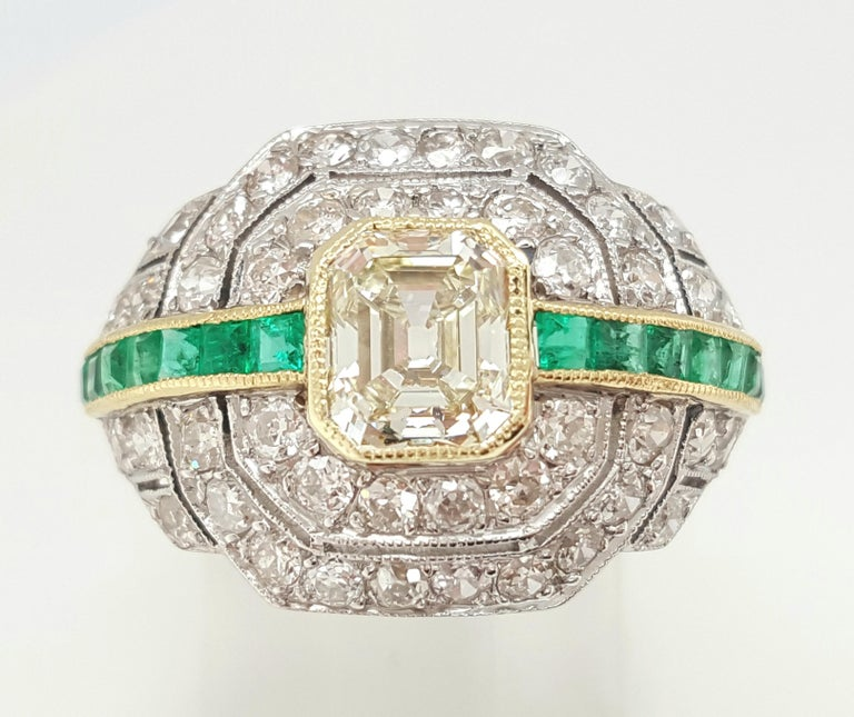 Women's Art Deco 1.24 Carat Emerald Cut Diamond and Emerald Platinum Ring For Sale