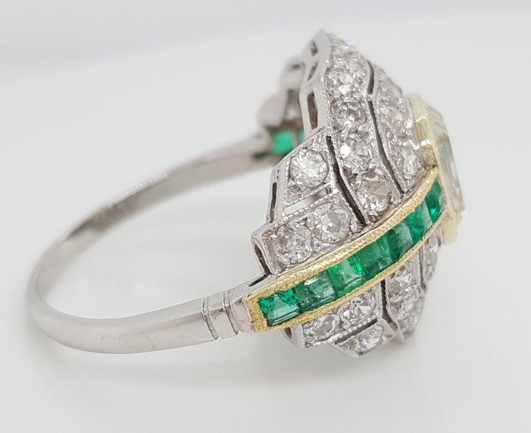 Art Deco 1.24 Carat Emerald Cut Diamond and Emerald Platinum Ring For Sale 4