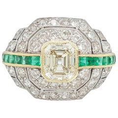 Art Deco 1.24 Carat Emerald Cut Diamond and Emerald Platinum Ring
