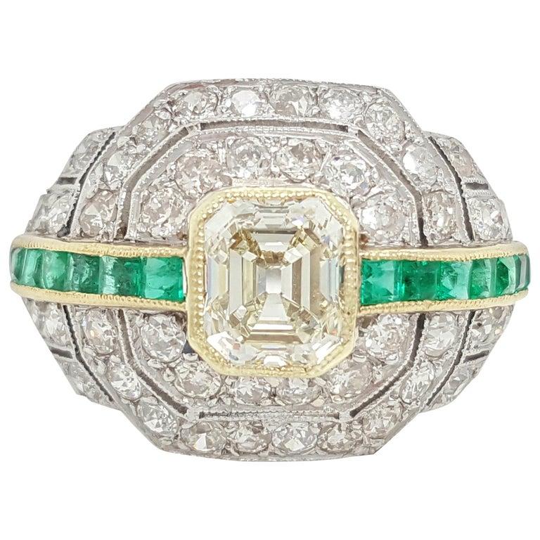 Art Deco 1.24 Carat Emerald Cut Diamond and Emerald Platinum Ring For Sale