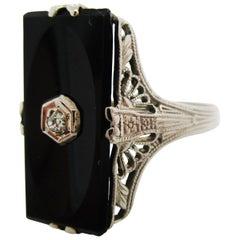 Art Deco 14 Karat Gold Filigree Black Onyx Diamond Ring