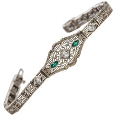 Art Deco 14 Karat Gold Filigree Link Bracelet with Emeralds and Old Cut Diamonds