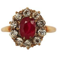 Art Deco 1.60 Carat Ruby and Diamond Halo Ring