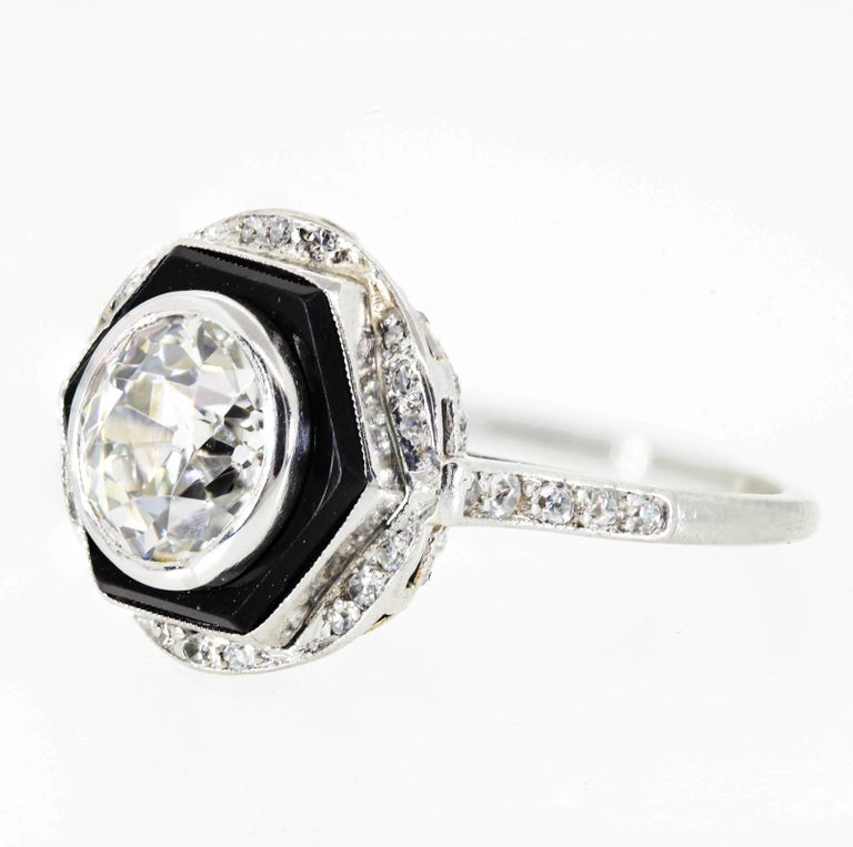 Hand created of platinum in the 1930s, this one of a kind beauty centers a sparkling 1.65 carat Old European cut Diamond - I/J color - SI1 clarity.  The diamond is surrounded by a hexagonal Onyx disc, making a stunning contrast to the white diamond.
