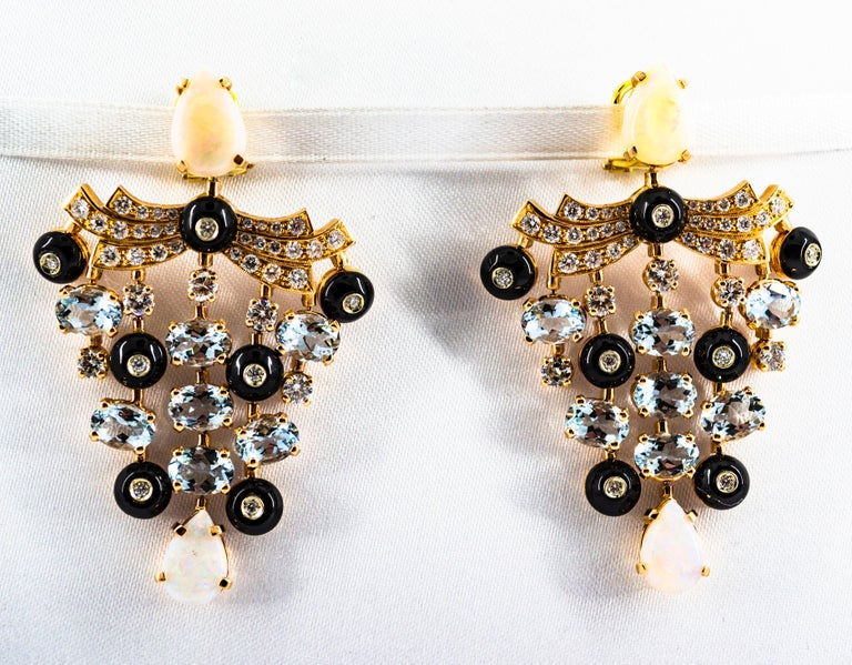 These Clip-On Earrings are made of 14K Yellow Gold. These Earrings have 2.81 Carats of White Modern Round Cut Diamonds. These Earrings have 9.80 Carats of Aquamarine. These Earrings have 5.22 Carats of Opal. These Earrings have also Onyx. All our