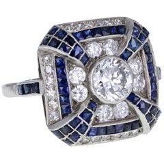 Art Deco 18 Carat Gold Diamond Calibré Sapphire 'Cushion' Shaped Cluster Ring