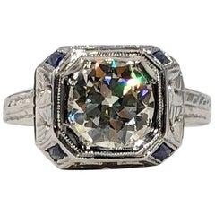 Art Deco 18 Karat 1.40 Carat European Cut Diamond and Sapphire Engagement Ring