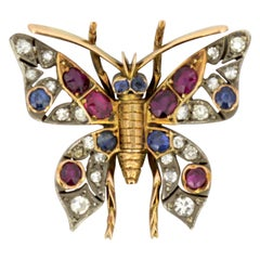 Art Deco 18 Karat Gold Butterfly Pendant with Rubies, Sapphires and Diamonds