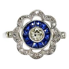 Art Deco 18 Karat White Gold Diamond and Blue Sapphire Daisy Target Ring