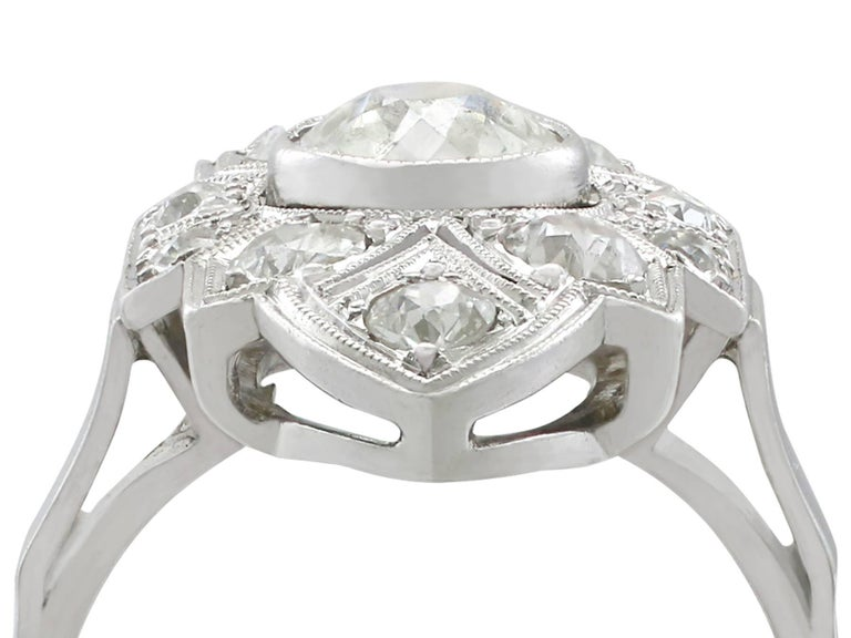 An impressive vintage Art Deco 1.91 Ct diamond and 14k white gold, platinum set marquise shaped dress ring; part of our diverse diamond jewelry collections.  This fine and impressive Art Deco white gold and diamond ring has been crafted in 14 Ct