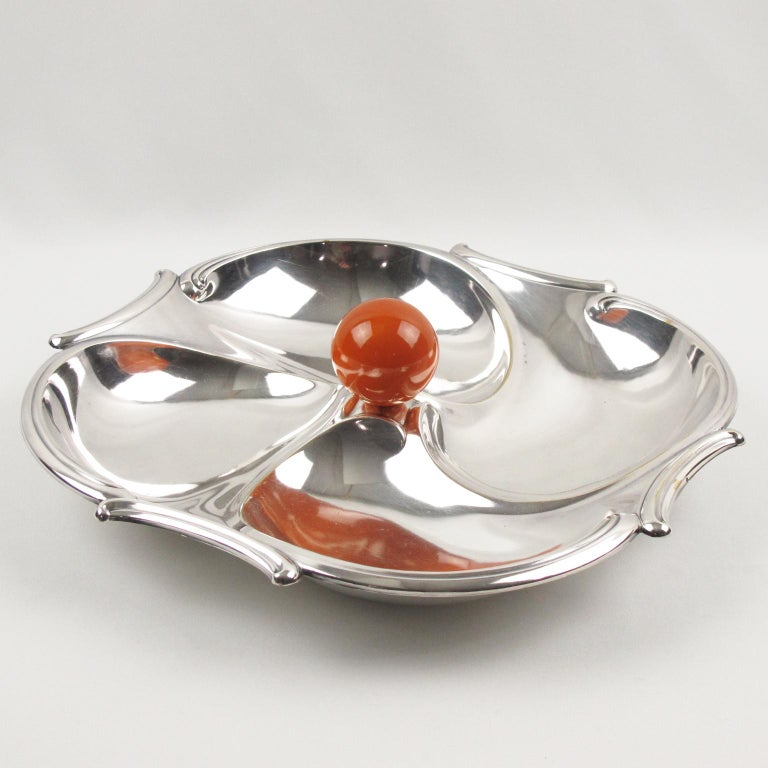 French Art Deco barware serving set for hors d'oeuvres, cocktail, snack, or appetizers by silversmith Maison Bezou, Paris. Featuring a large dimensional rounded polished silver plate serving tray with four compartments and an orange Bakelite ball