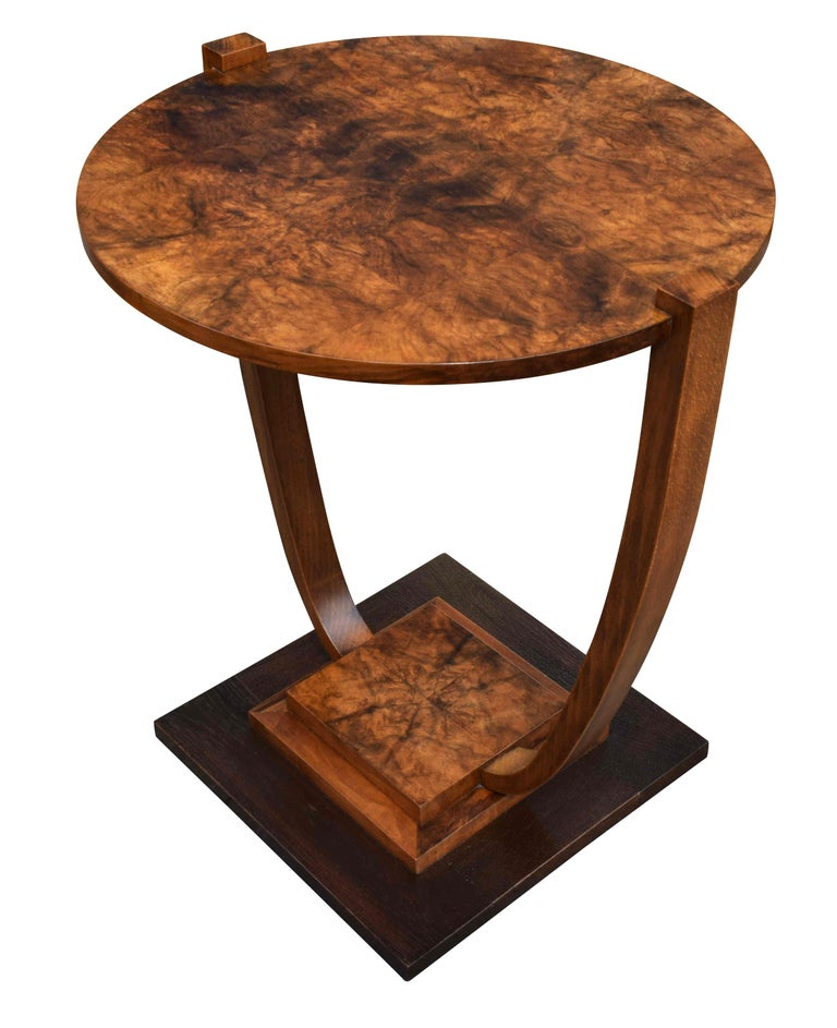 A very stylish 1930s Art Deco French occasional table very much in the style of Leleu. Beautiful walnut veneers and two-tiered with an ebonized stepped base. Typically French in style and would make a great focal point to any room, looks great from