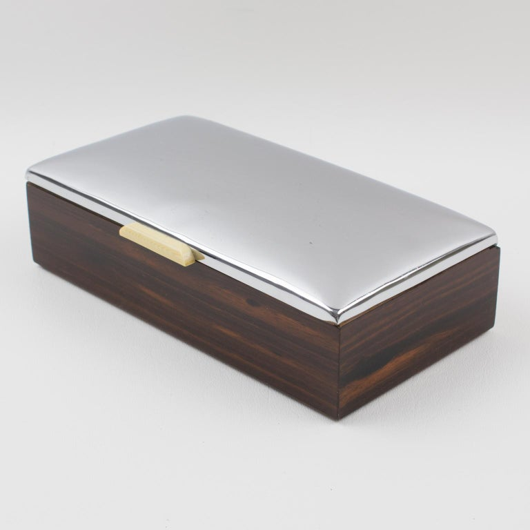 Stylish French Art Deco decorative lidded box. Domed chromed metal lid with a Macassar wood base. Interior in mahogany. A tiny off-white Galalith handle on the front. Marked underside: