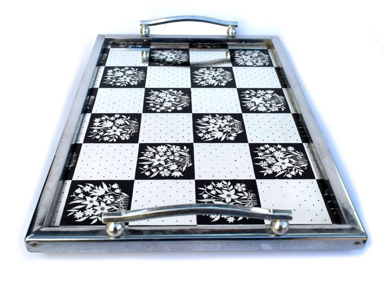 Very stylish and in superb condition is this English, 1930s Art Deco mirrored drinks tray. The chrome surround and handles with ply base support a chequered effect mirrored glass base. Very glamorous and ideal for serving drinks on or even use as