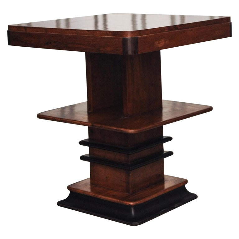 1930s walnut and lacquered Art Deco three-tiered graduated side tables.