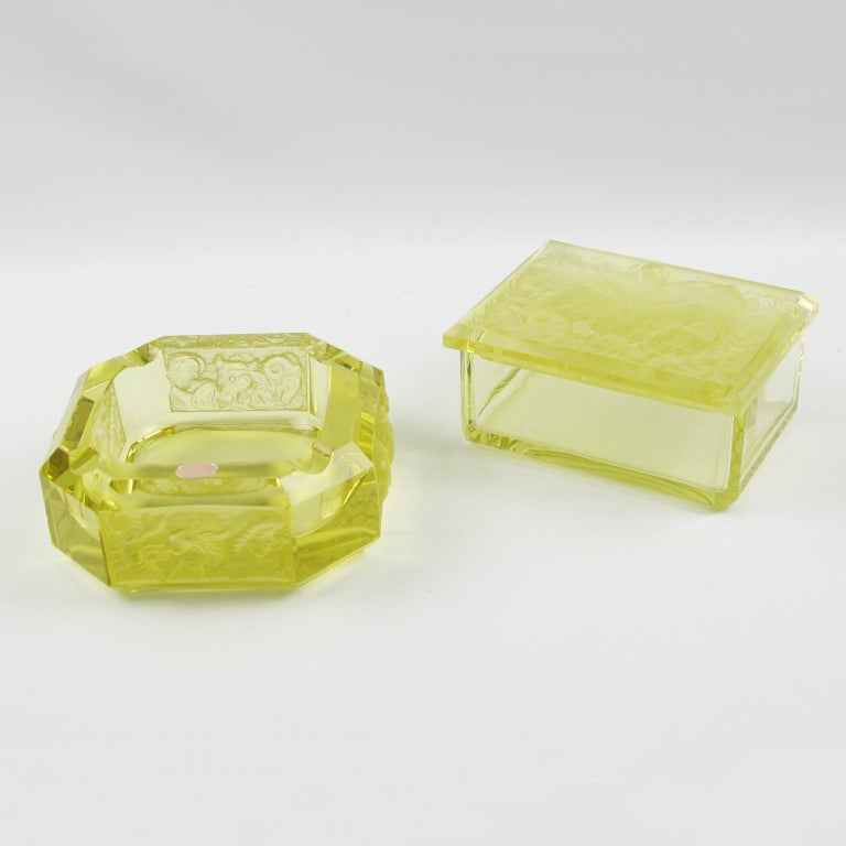 Lovely Bohemian Art Deco glass set for living space or office. Czech set featuring ashtray and decorative lidded box in cut and molded thick and heavy glass. Unusual yellow ouraline Vaseline color. The box has molded design on top of the lid with