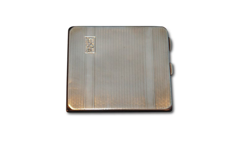 Art Deco 1931 solid silver cigarette case with monogram by Adie Brothers of Birmingham England.  Case has been monogrammed as seen in image. Also includes the original inner strap to hold the cigarettes.  (Peaky Blinders enthusiasts will love this