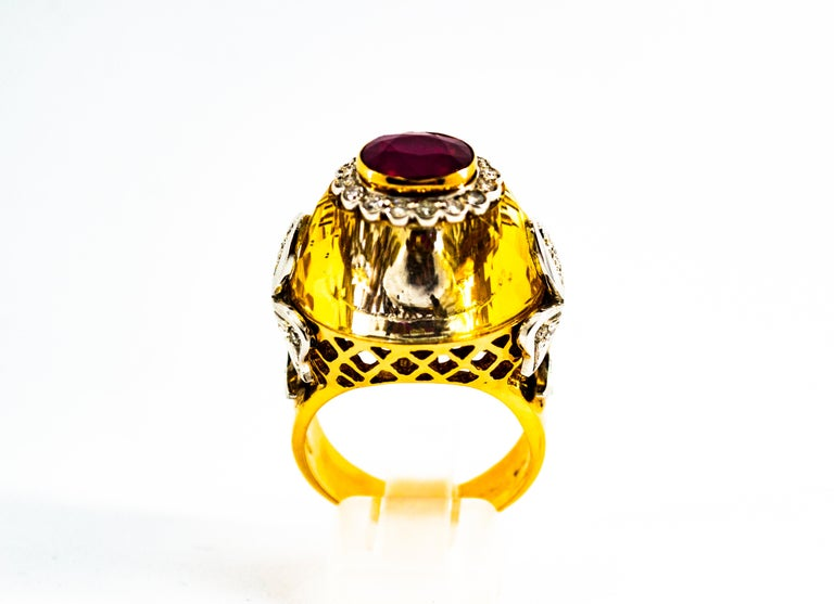 This Ring is made of 14K Yellow Gold. This Ring has 0.60 Carats of White Modern Round Cut Diamonds. This Ring has a 1.20 Carats Natural Heated Oval Cut Ruby. This Ring has also a big Natural Citrine. Size ITA: 21 Size USA: 9.5 We're a workshop so