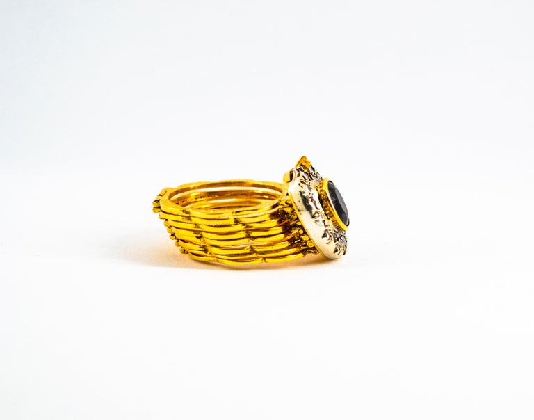 This Ring is made of 9K Yellow Gold and Sterling Silver. This Ring has 0.25 Carats of White Rose Cut Diamonds. This Ring has a 1.80 Carats Blue Sapphire. This Ring is available also with a Ruby or an Emerald. Size ITA: 18 USA: 8 1/4  This Ring can