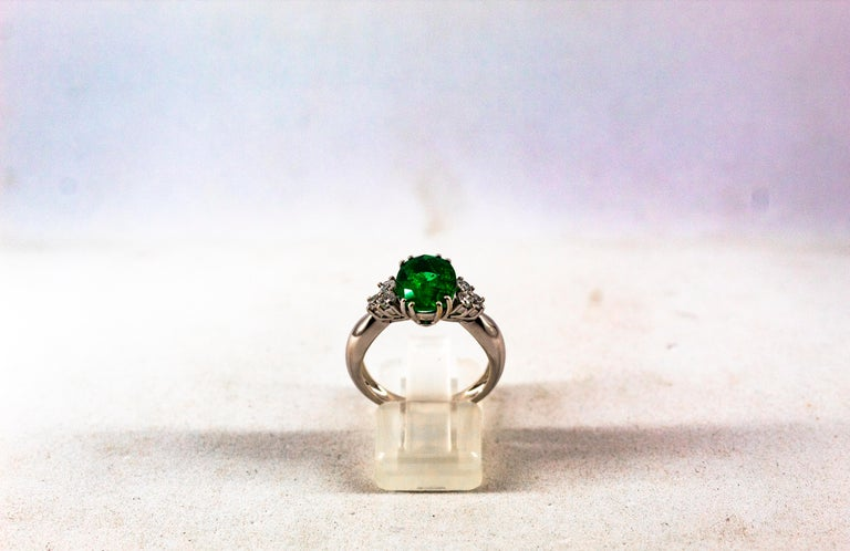 This Ring is made of 18K White Gold. This Ring has 0.35 Carats of White Modern Round Cut Diamonds. Color: H-G Clarity: VVS1 This Ring has a 2.43 Carats Natural Zambia Oval Cut Emerald. This Ring is inspired by Art Deco. Size ITA: 14.5 USA: 7 We're a