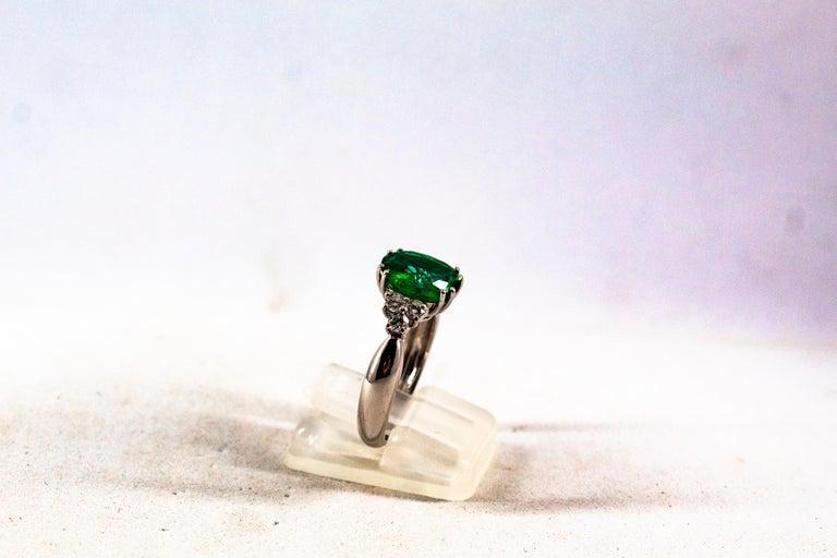 Women's or Men's Art Deco Style 2.43 Carat Emerald 0.35 Carat Diamond White Gold Cocktail Ring For Sale