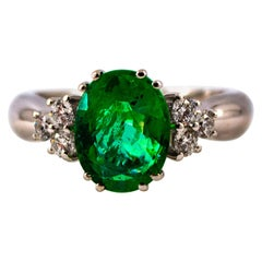 Art Deco Style 2.43 Carat Emerald 0.35 Carat Diamond White Gold Cocktail Ring