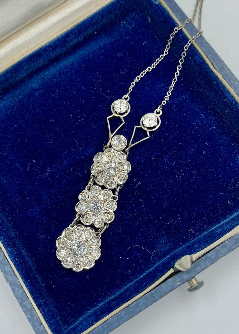 A stunning antique Art Deco - Victorian - Edwardian Platinum Diamond Lavaliere Pendant Necklace with 32 sparkling white Old European Cut Diamonds of great beauty in a gorgeous platinum setting.  This original Art Deco pendant necklace contains 2.7