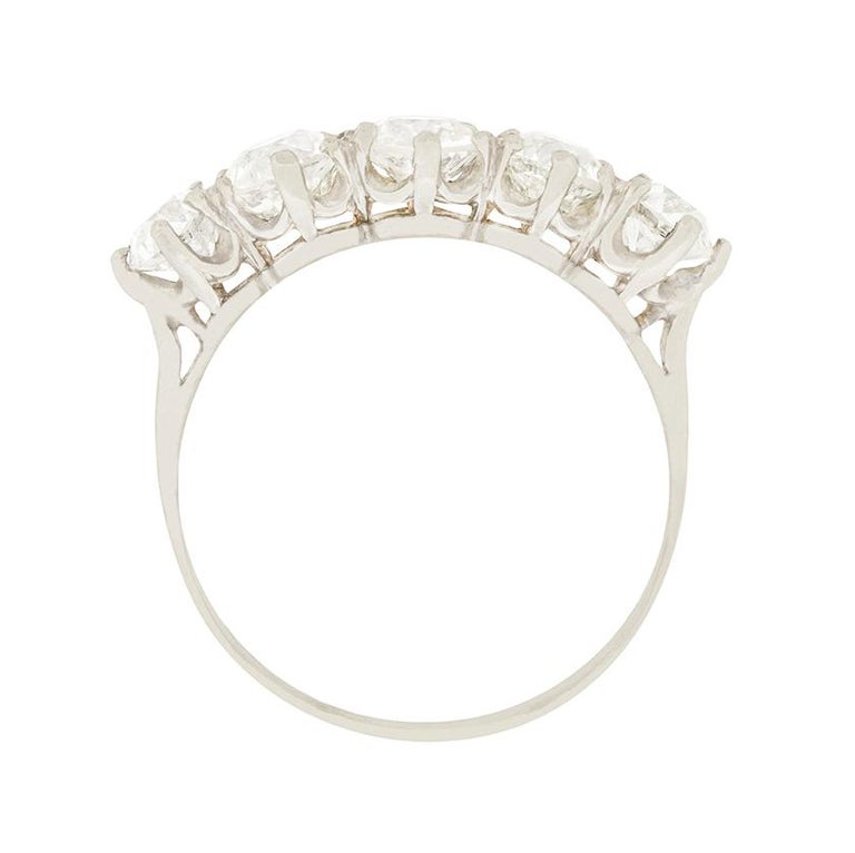 This stunning art deco ring features five old cut diamonds set in platinum. The centre diamond is 0.70 carat, the diamonds to either side are 0.65 carat each, while the diamonds on the ends are 0.40 carat each. They match for quality, and are G to I