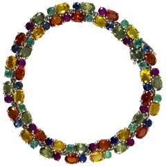 Art Deco 29.00 Carat Blue Yellow Green Sapphire Emerald Ruby White Gold Bracelet