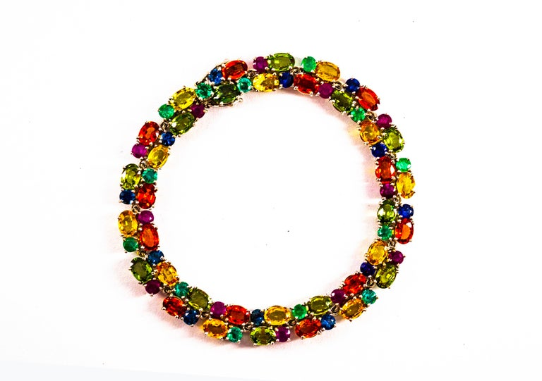 This Bracelet is made of 18K White Gold. This Bracelet has 2.40 Carats of Emeralds. This Bracelet has 2.30 Carats of Rubies. This Bracelet has 2.30 Carats of Blue Sapphires. This Bracelet has 22.00 Carats of Green and Yellow Sapphires. This Bracelet
