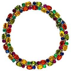 Art Deco 29.00 Carat Emerald Ruby Blue Yellow Green Sapphire White Gold Bracelet