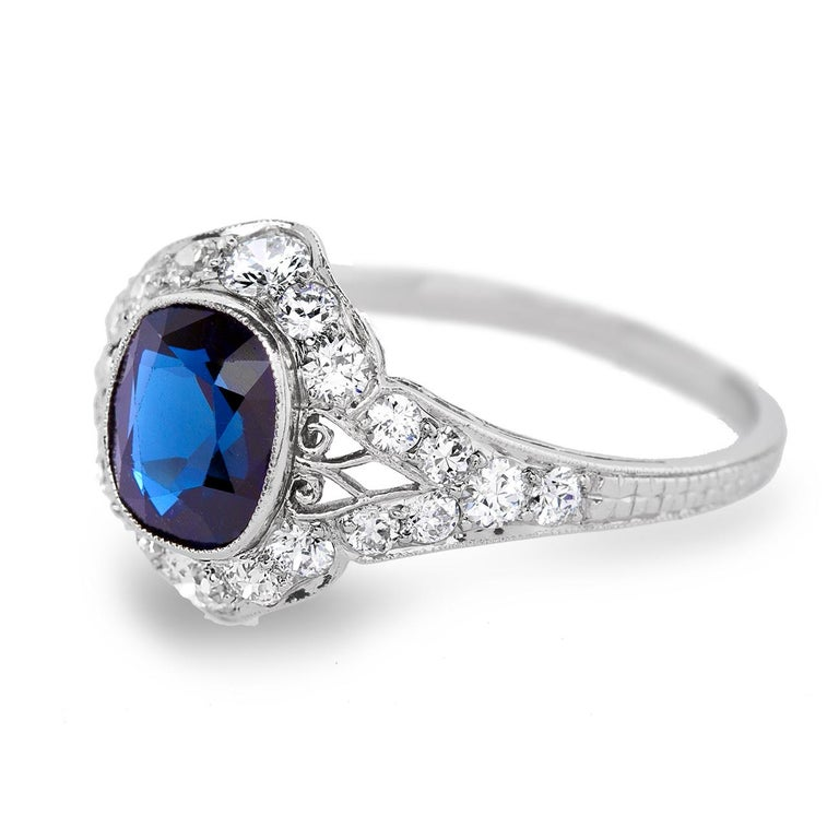 This Delightful Art Deco sapphire and diamond ring is set in platinum with a deep royal blue no heat sapphire weighing approx. 3 carat. surrounded with high white clean old mine brilliant diamonds. This beautiful royal blue sapphire exhibits a