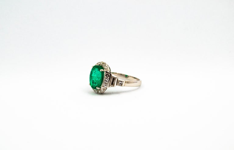 This Ring is made of 18K White Gold. This Ring has 0.90 Carats of White Modern Round Cut, Baguette Cut and Princess Cut Diamonds. This Ring has a 3.30 Carats Brazilian Oval Cut Emerald (10.80mm x 8.30mm). Size ITA: 17 USA: 8 We're a workshop so