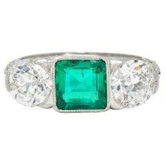 Art Deco 3.30 Carats Diamond Emerald Platinum Three Stone Ring