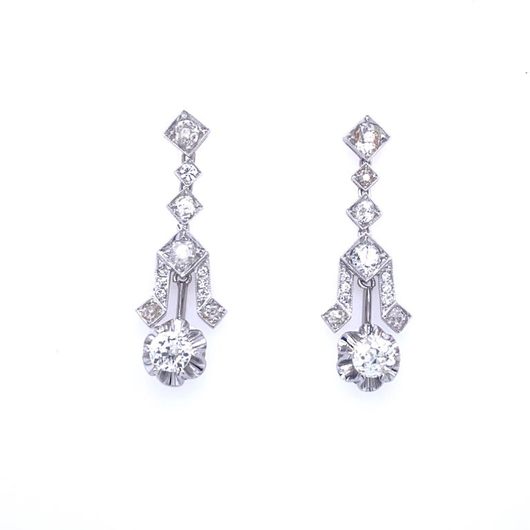 Timeless pair of diamond 18k white gold drop earrings feature sparkling old mine cut diamonds that weigh approximately 4.00ct. total, graded G/H/I color with VS clarity. Authentic Art Deco Circa 1930  CONDITION: Pre-owned - Excellent  METAL: 18k