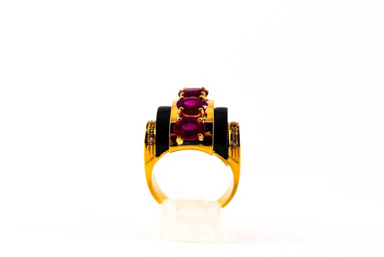 This Ring is made of 14K Yellow Gold. This Ring has 0.15 Carats of White Diamonds. This Ring has 5.10 Carats of Rubies. This Ring has Onyx. This Ring is available also with Emeralds. Size ITA: 20 USA: 9 1/4 We're a workshop so every piece is