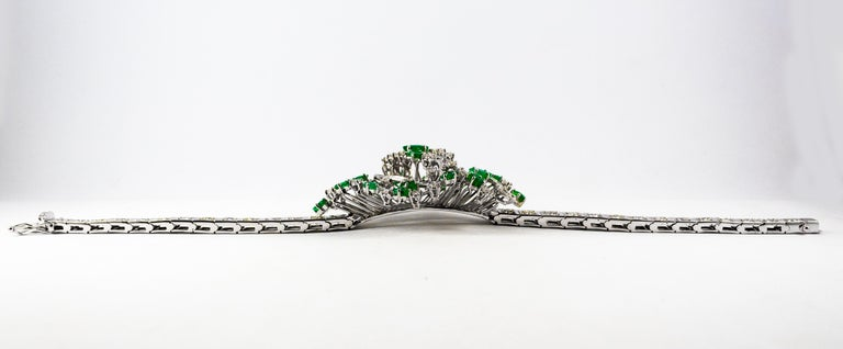 This Bracelet is made of 18K White Gold. This Bracelet has 5.20 Carats of White Diamonds. This Bracelet has 3.60 Carats of Natural Emeralds. We're a workshop so every piece is handmade, customizable and resizable.