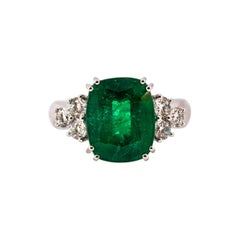 Art Deco 5.73 Carat Emerald 0.74 Carat White Diamond White Gold Cocktail Ring