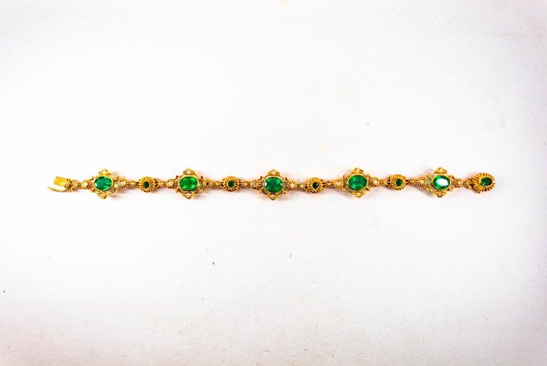 Art Deco Style 6.60 Carat Emerald 0.60 Carat White Diamond Yellow Gold Bracelet For Sale 2