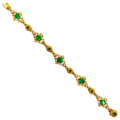 Art Deco Style 6.60 Carat Emerald 0.60 Carat White Diamond Yellow Gold Bracelet