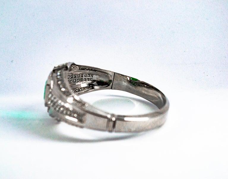 Art Deco Style 7.10 Carat Emerald 7.40 Carat White Diamond Gold Clamper Bracelet For Sale 6