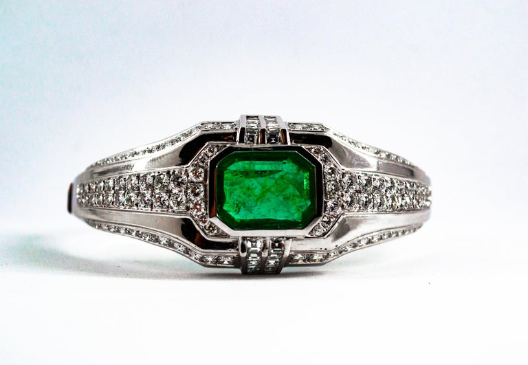 This Bracelet is made of 18K White Gold. This Bracelet has 7.40 Carats of White Modern Round Cut and Princess Cut Diamonds. This Bracelet has a 7.10 Carats Colombia Natural Emerald Cut Emerald. This Bracelet is inspired by Art Deco. We're a workshop