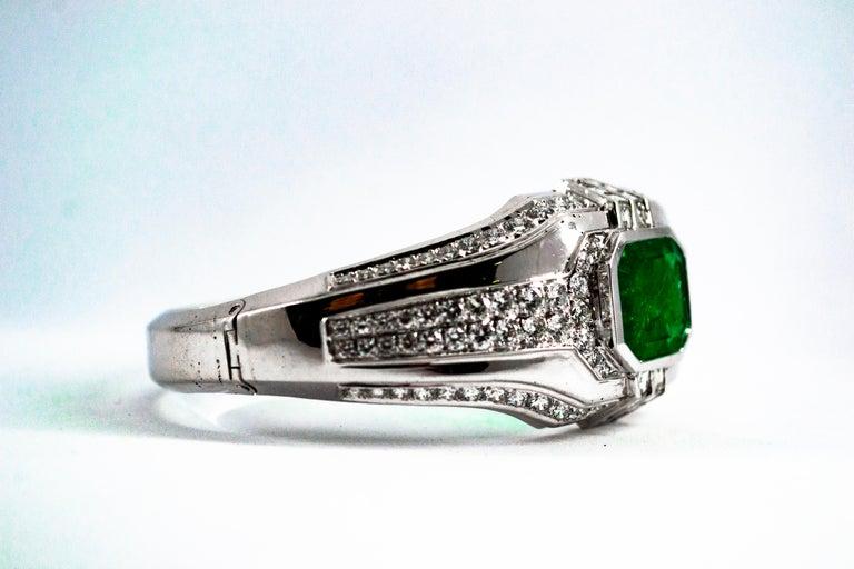 Women's or Men's Art Deco Style 7.10 Carat Emerald 7.40 Carat White Diamond Gold Clamper Bracelet For Sale