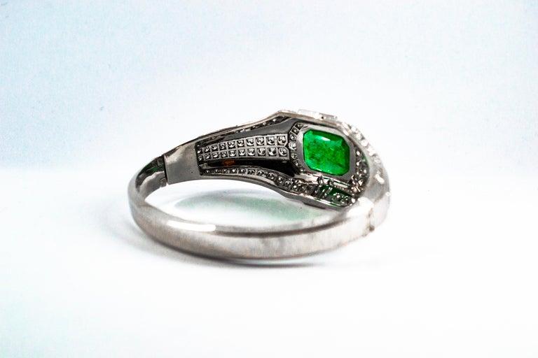 Art Deco Style 7.10 Carat Emerald 7.40 Carat White Diamond Gold Clamper Bracelet For Sale 2