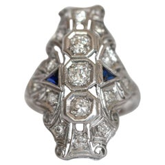Art Deco .76 Carat Old European Cut Diamond and Blue Sapphire Shield Ring